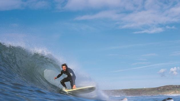 Ride the waves at Pembs Freshwater West in Wales.