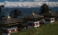 Bhutan stupas with Himalayan peaks in the distance