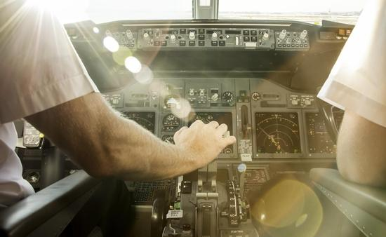 Pilots before take off, cockpit, airplane