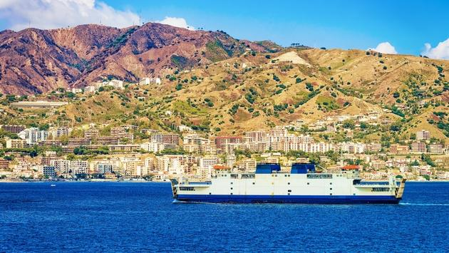 Passenger ferry in Mediterranean Sea and cityscape Messina Sicily island