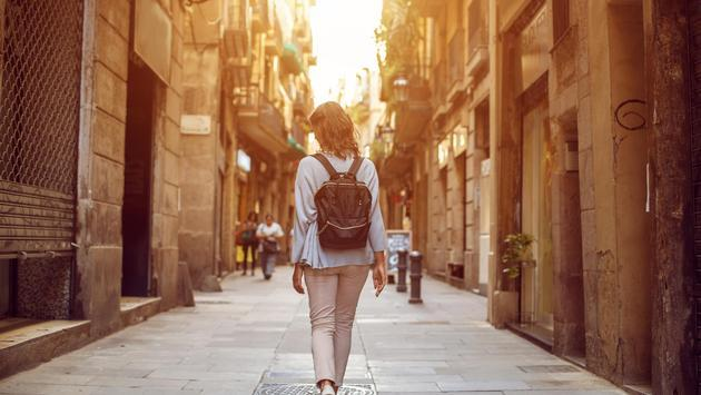 Traveling female walking on European city street