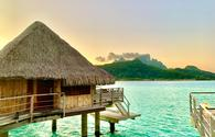 Overwater bungalows and mountain on Bora Bora lagoon