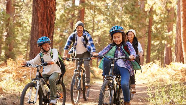 Black family mountain biking.