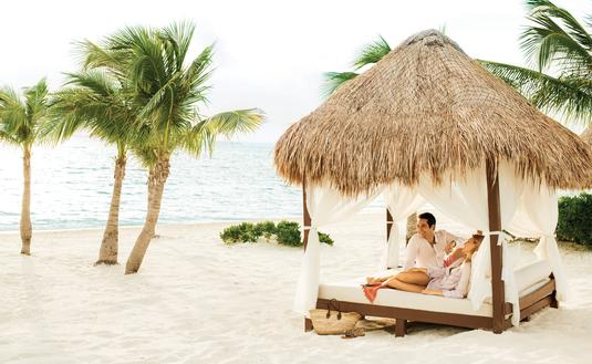 A couple relaxing at Excellence Playa Mujeres