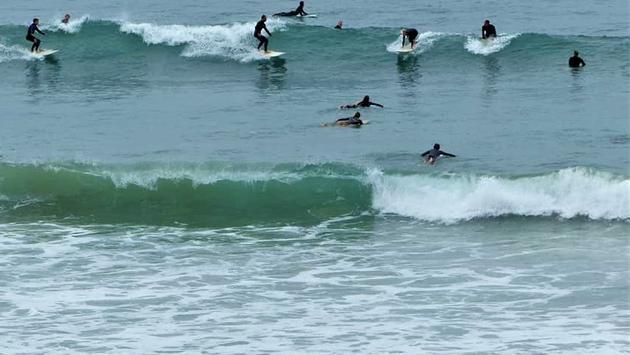 Surfers at T-Street Beach