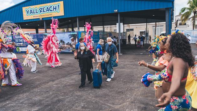 Dancers greet passengers
