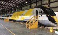 Brightline train stopped in station.