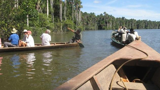 Brazil travelers are exploring areas beyond Rio de Janiero. Shown here is a canoe excursion in Brazil's Tambopata National Reserve. (Photo by Brian Major)