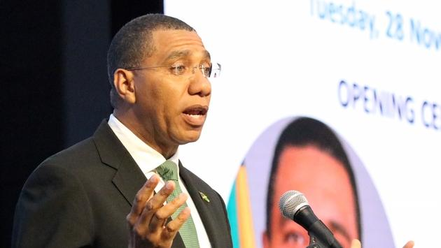 Jamaican Prime Minister Andrew Holness, speaks to the crowd at UNWTO.