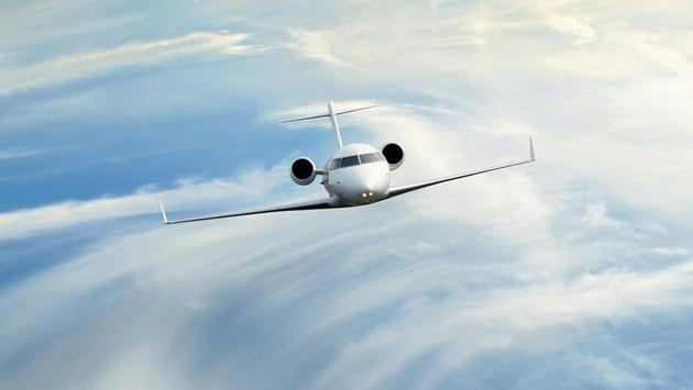 Private jet in the clouds
