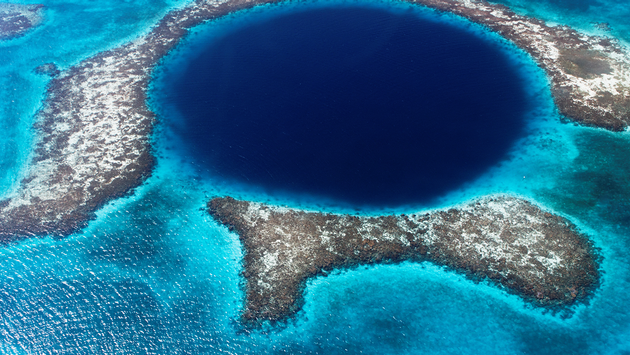the great blue hole of belize (PHOTO: Photo via Lomingen / iStock / Getty Images Plus)