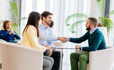 Couple meeting with a travel agent, travel advisor
