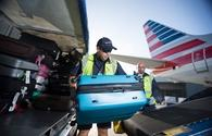 American Airlines fleet team members unloading baggage from aircraft