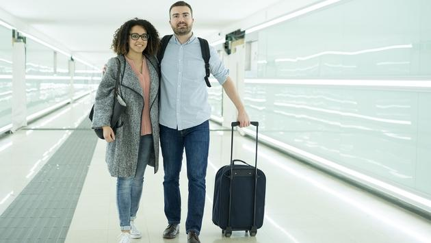 couple with a suitcase ready for travel