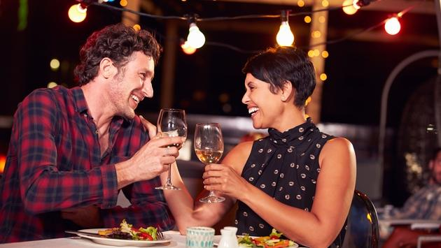 Couple eating dinner at rooftop restuarant