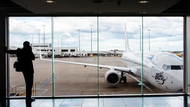 A passenger looks out from Melbourne Airport