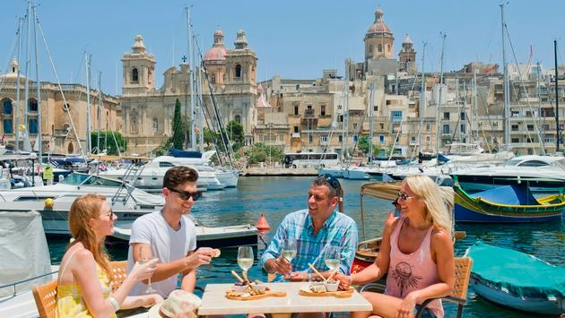 People enjoying food in Birgu, Malta.