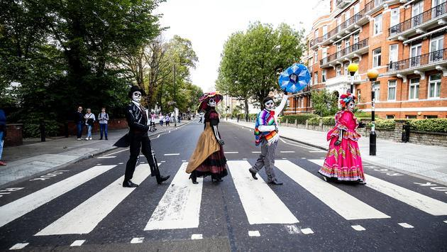 Day of the Dead characters crossing London's Abbey Road