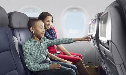 Parent and Child inside airplane (Photo via American Airlines)