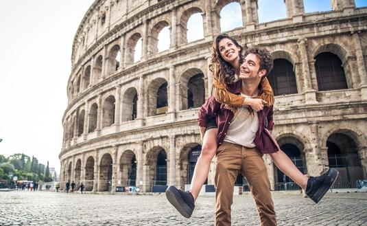 Couple at Colosseum, Rome (Photo via oneinchpunch / iStock / Getty Images Plus)