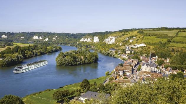 The Scenic Gem sails alongside Normandy.