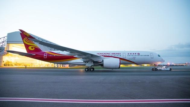 A new Hong Kong Airlines A350 rolls out of the paint shop.