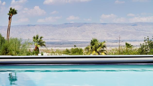 A pool with a view of the mountains in Palm Springs, California