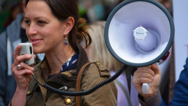Megaphone, protest, voice, travel agent