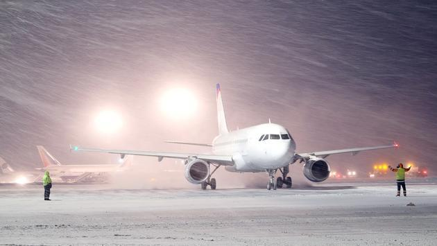 Winter storm causes plane to skid off runway at Chicago airport