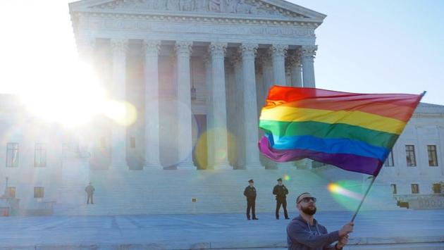 An LGBTQ pride flag flying at the United States Supreme Court