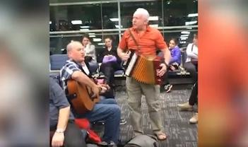 Sean Sullivan, on guitar, and Sheldon Thornhill on accordion, livened up their flight delay with a Newfoundland kitchen party!