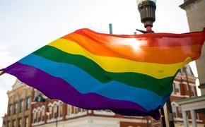 LGBT rainbow flag outside in the sun (Photo via iStock / Getty Images Plus)