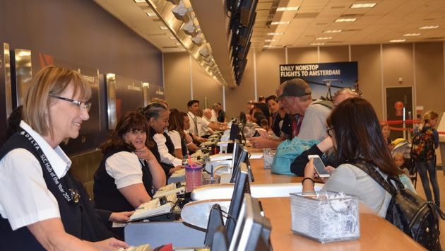 Delta employees assisting customers in Salt Lake City