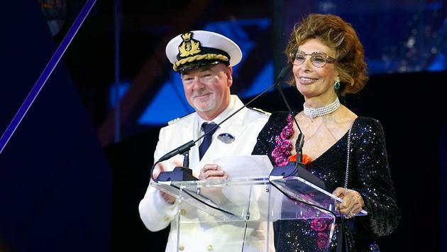 MSC Seaside godmother Sophia Loren addresses the crowd as captain Pier Paolo Scala looks on