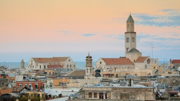 Cityscape of Bari at sunset with Basilica of San Nicola and Romanesque Cathedral
