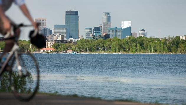 Minneapolis lifestyle scenic with biker on Lake Calhoun