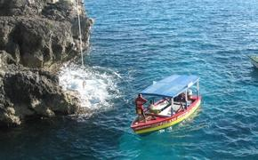 Visitors can watch cliff divers at Rick's Cafe in Jamaica