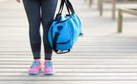 Woman carrying a blue gym bag