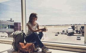 Young woman waiting for a plane