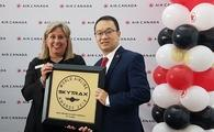 Lucie Guillemette, Air Canada CCO, and Andrew Yiu, Air Canada vice president of Product, hold the airline