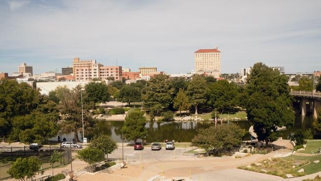 Fall Afternoon Blue Sky Lubbock Texas Downtown City Skyline Riverfront Park (photo courtesy of ChrisBoswell / iStock / Getty Images Plus)
