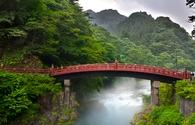 Red sacred bridge Shinkyo in Nikko, Japan and a mist rising from the river.