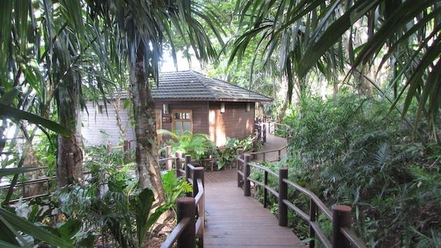 Bungalows at Guatemala's Las Lagunas Hotel bungalows are linked by wooden walkways lined with lush native trees, plants and flowers.