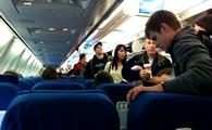 Passengers boarding a commercial aircraft