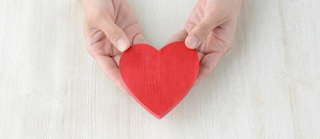 Travel agent holding a heart