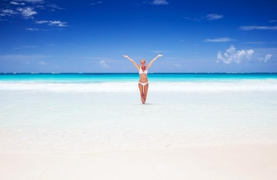 Happy woman on the beach in Cancun, Mexico
