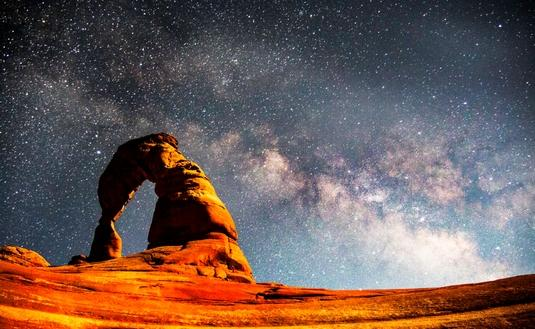 The Milky Way above Delicate Arch in Arches National Park.