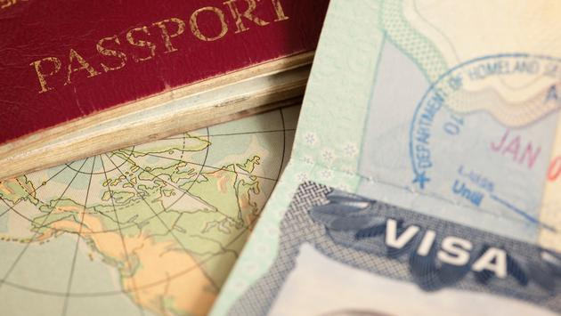 U.S. and U.K. passports on a vintage world map.