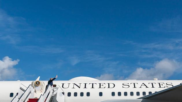 President Donald Trump boards Air Force One at Palm Beach International Airport