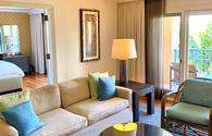 One bedroom suite with tones of cream and green with lanai and palm tree